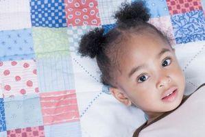Frisurer for afrikansk-amerikanske buksetrold piger